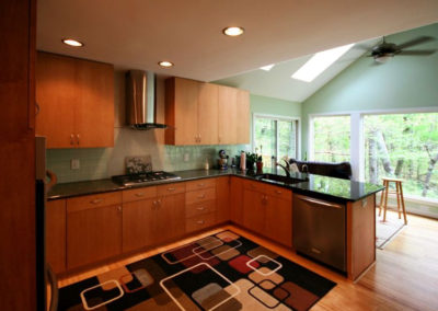 Sleek modern kitchen with sun room