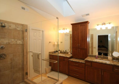 Spacious shower and updated vanity with much needed storage