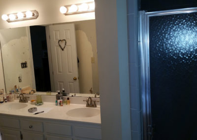 Outdate vanity and cramped shower