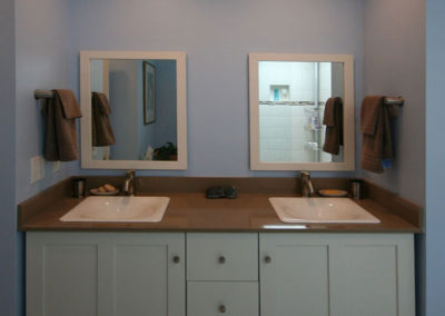 Updated bathroom vanity with added linen closets